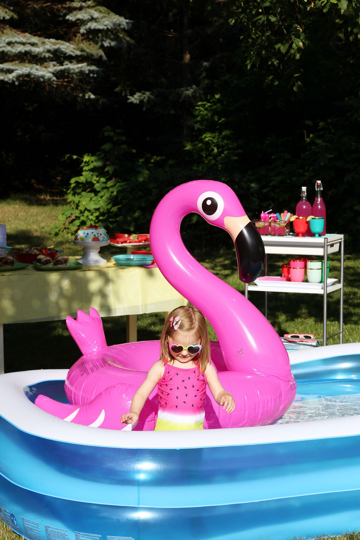 Summer fun pool party with pink flamingo pool float