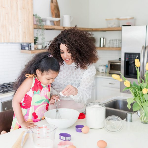 Mother and daughter in the kitchen baking